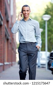 Portrait of happy businessman talking on mobile phone