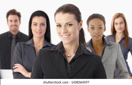 Portrait of happy businesswoman and business team looking at camera, smiling, isolated on white.