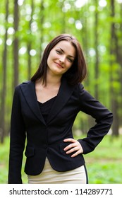 Portrait of happy businesswoman with hand on her hip