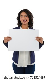 Portrait of happy businesswoman holding blank placard against white background