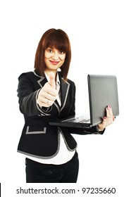 A portrait of a happy businesswoman holding a laptop and giving thumbs up. Isolated on white background