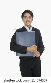Portrait of a happy businesswoman smiling with a file