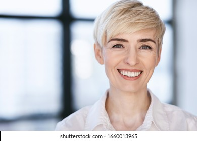 Portrait Of Happy Businesswoman Smiling Looking At Camera Posing In Modern Office. Successful Business People. Selective Focus