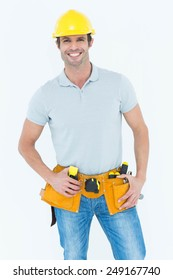 Portrait of happy carpenter wearing hard hat over white background