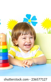 Portrait of a Happy cheerful baby at kindergarten or playgroup, over white background with copy space.
