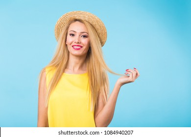 Portrait of happy cheerful smiling young beautiful blond woman on blue background