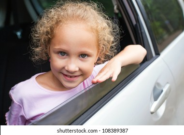 Portrait of happy child in the car