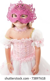 Portrait of Happy child with a carnival mask .