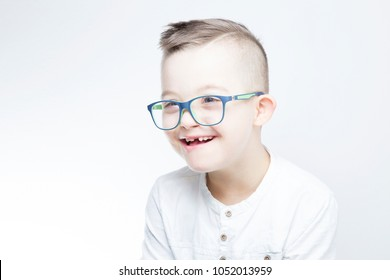Portrait of happy child with down syndrome.