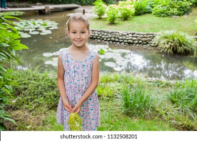Portrait of happy child in elegant dress at nature, beautiful spring day, child outdoor portrait