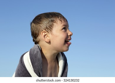 Portrait of a happy child on a sky background