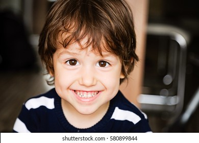 Portrait of happy child toddler boy smiling close up