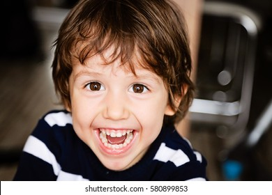 Portrait of happy child toddler boy smiling and laughing close up