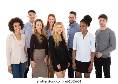 Portrait Of Happy College Students Standing Against White Backgrounds
