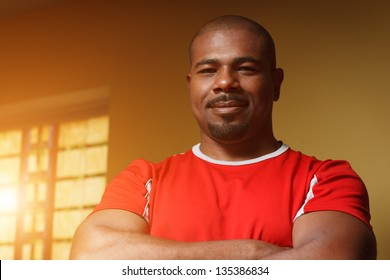 Portrait of happy confident African American male athlete. Closeup.