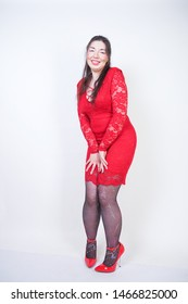 Portrait of happy and confident plus size model in red dress