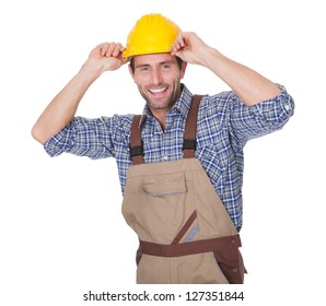 Portrait of happy construction worker. Isolated on white