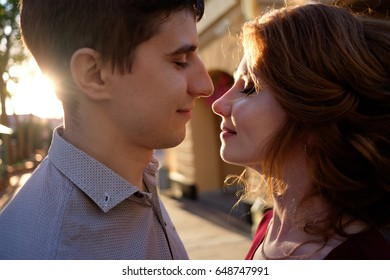 portrait of happy couple before kiss in sunset light. Love concept
