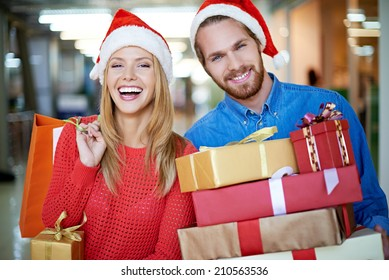 Portrait of happy couple with Christmas presents