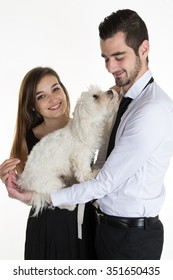 Portrait of happy couple with dog over white background