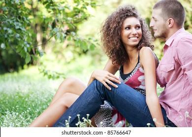 Portrait of happy couple embracing outdoor in park