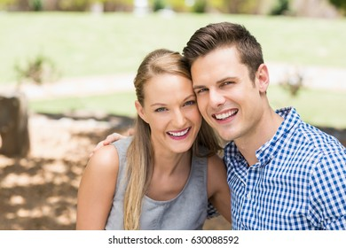 Portrait of happy couple enjoying together in a park