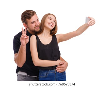 Portrait of happy couple making selfie, isolated on white background.