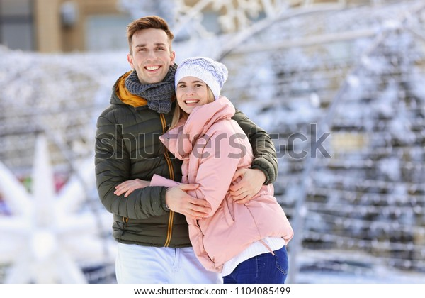 Portrait of happy couple outdoors on winter day