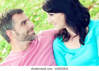Portrait of a happy couple outdoors in the park