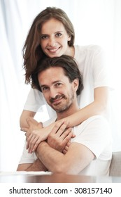 portrait of happy couple in a room