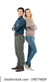 Portrait Of Happy Couple Standing With Arm Crossed Looking At Camera Isolated On White Background