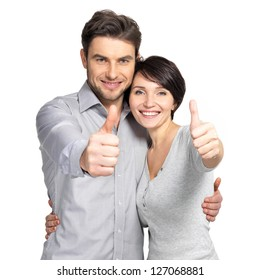 Portrait of happy couple with thumbs up sign isolated on white background