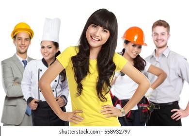 portrait of happy customer standing in front of her house contractor or builder