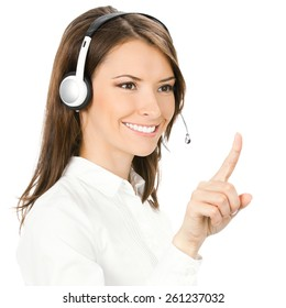 Portrait of happy customer support phone operator in headset pointing at something, isolated against white background