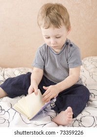 portrait of happy cute little  boy with book