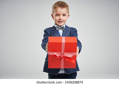 Portrait of happy cute little kid holding gift