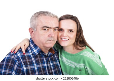 Portrait of happy daughter and father against white background
