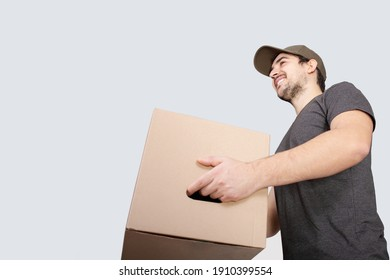 Portrait of happy delivery man holding a box package and showing thumbs up. Delivery man with a parcel  showing thumb up for evaluating a good experience or service.  Excellent customer service .