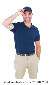 Portrait of happy delivery man wearing cap on white background
