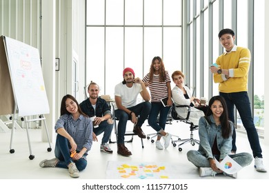 Portrait of happy diverse creative business team group looking at camera and smiling. Multiethnic success designer start up team working together on creative project. Group shot style.