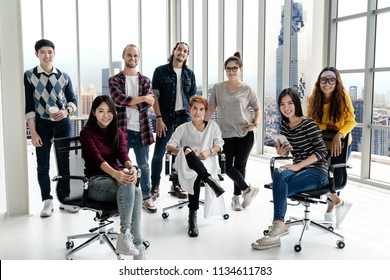 Portrait of happy diverse creative business team group looking at camera and smiling. Multiethnic success designer start up team working together on creative project. Group shot partnership concept.