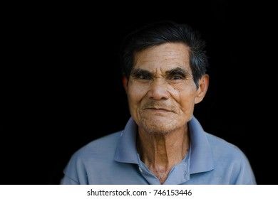 Portrait of  happy elder of man smiling isolated on black