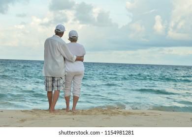 Portrait of a happy elderly couple resting