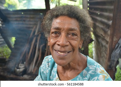 Portrait of happy elderly indigenous Fijian woman in her 70's looking at the camera and smile.  Real people copy space