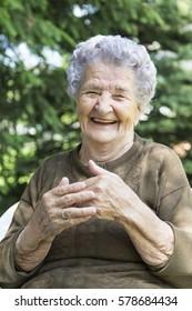 Portrait of happy elderly women sitting in garden. Old women