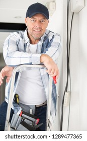 portrait of happy electrician smiling at the camera