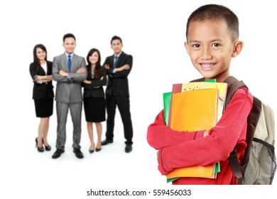 portrait of happy elementary student with books and his teacher at the background