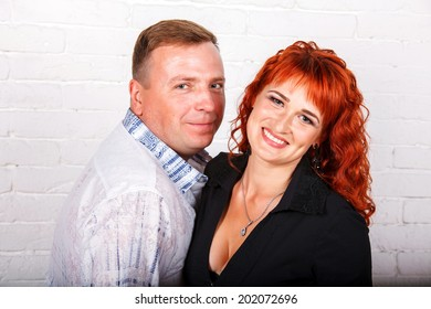Portrait of happy embracing couple in casual