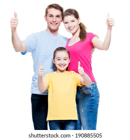 Portrait of the happy european family with child shows the thumbs up sign - isolated on white background.
