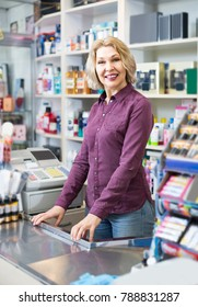 Portrait of happy european mature store clerk at household and cosmetic shop